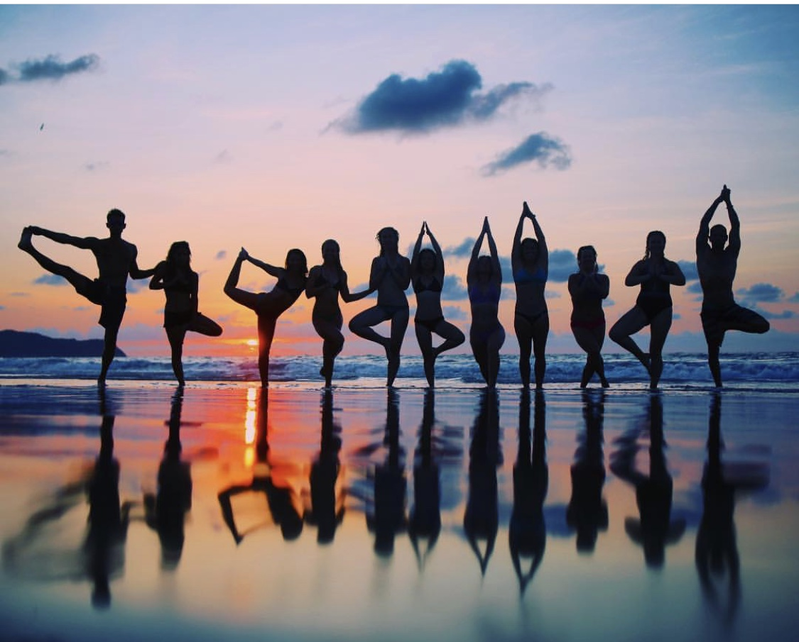Guests doing yoga at sunset at the MedTreks Wellness & Yoga Retreat in Mexico