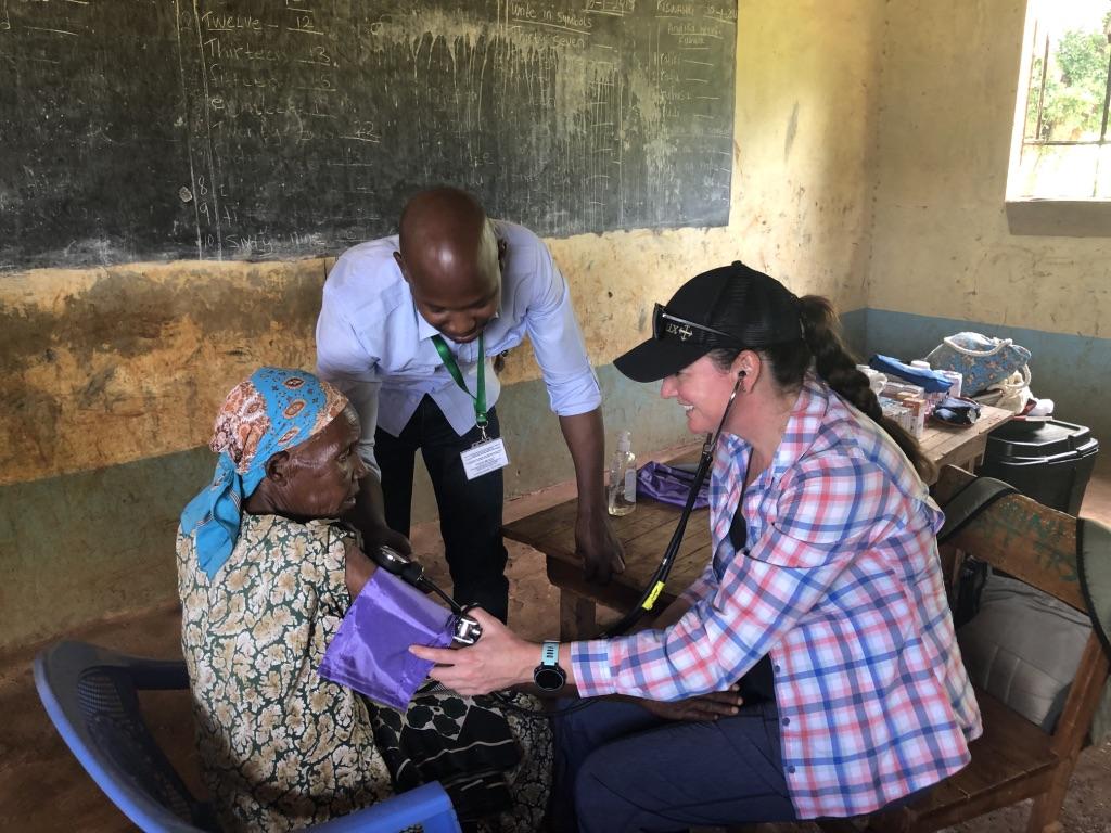 Medical volunteer in Kenya meets with a patient