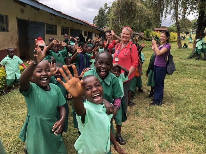 Medical volunteers working with kids on our MedTreks Kenya trip
