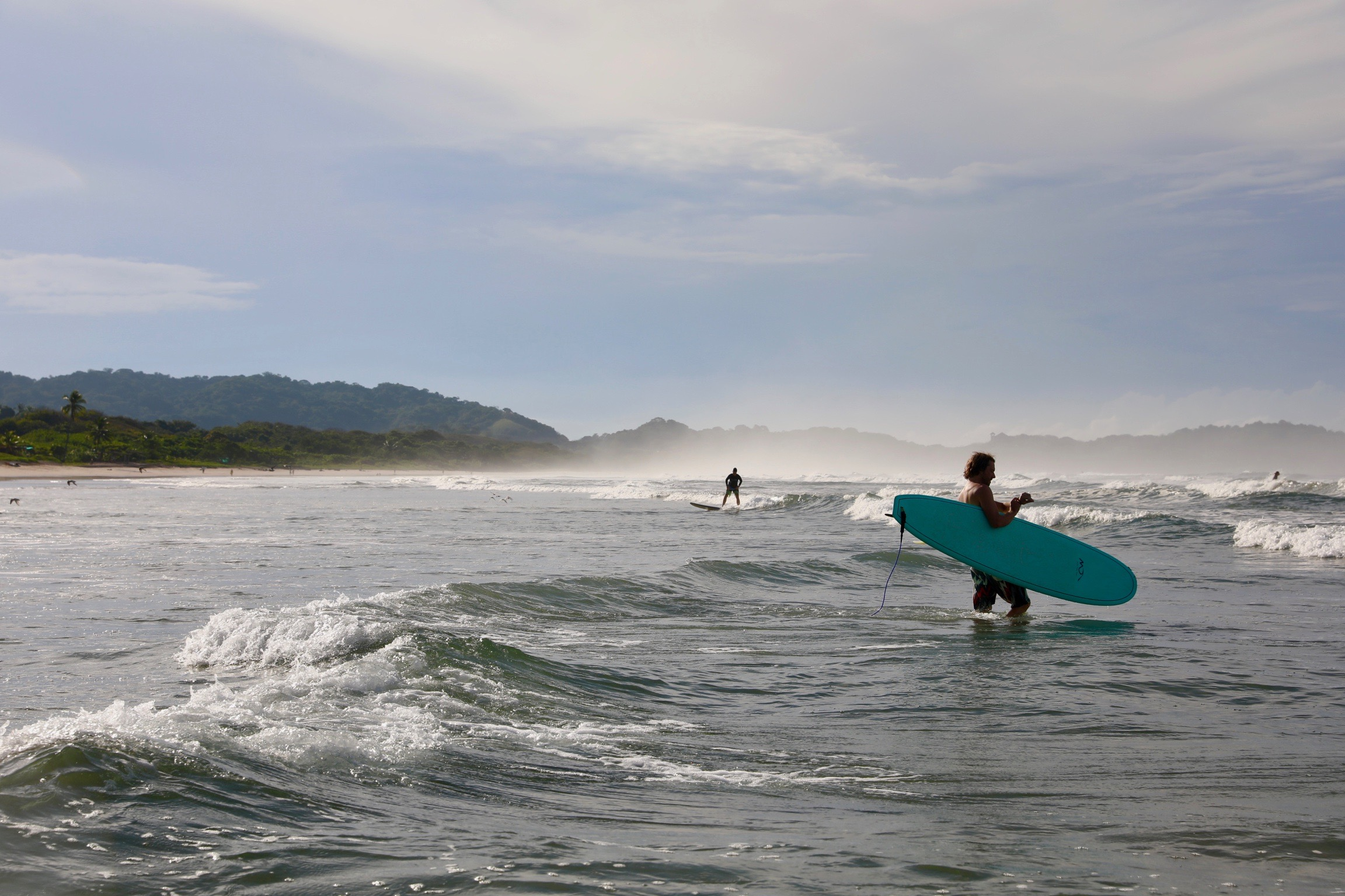 Students take a surf break during their medical Spanish course Nosara, Costa Rica