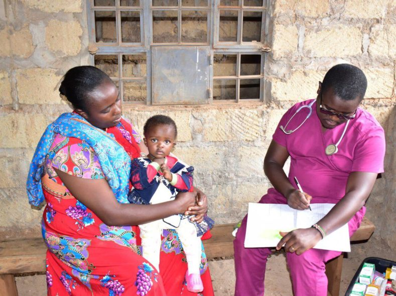 Medical volunteer in Kenya meets with a patient at our clinic