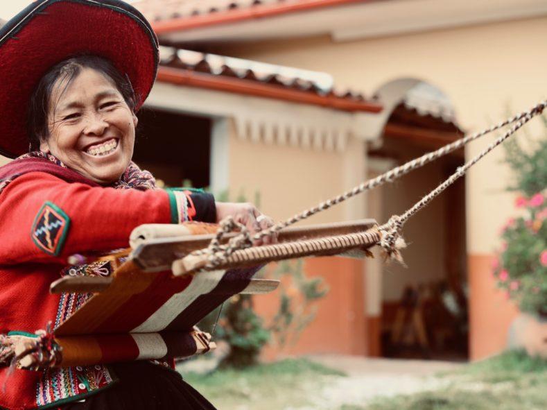 Woman weaves fabric in Sacred Valley on MedTreks Peru trip